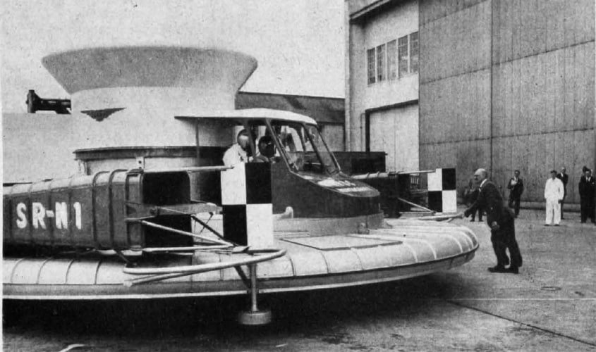 Christopher Cockerell, inventor of the hovercraft, pushing his prototype machine