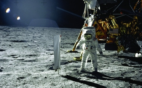"Astronaut Edwin E. Aldrin, Jr., lunar Module pilot, is photographed during the Apollo 11 extravehicular activity (EVA) on the lunar surface. In the right background is the Lunar Module ""Eagle."" On Aldrin's right is the Solar Wind Composition (SWC) experim"