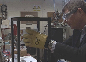 Professor David Cardwell tests a sample superconductor in his lab