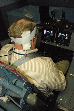 A three-time space shuttle commander uses the Galvanic vestibular stimulation (GVS) system during a space shuttle landing simulation. The GVS delivers small amounts of electricity to the vestibular nerve, which then sends the signals to the brain, resulti