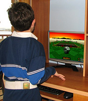 A child fitted with an accelerometer trials a computer game designed to encourage movement