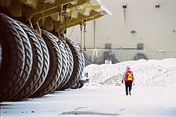At the Muskeg River Mine the world's largest trucks use giant shovels to excavate the ore containing the bitumen