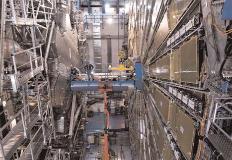 Cox works on the ATLAS detector at the Large Hadron Collider