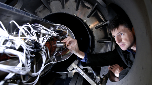 SCRAMSPACE project lead Prof Boyce with the prototype engine in the shock tunnel
