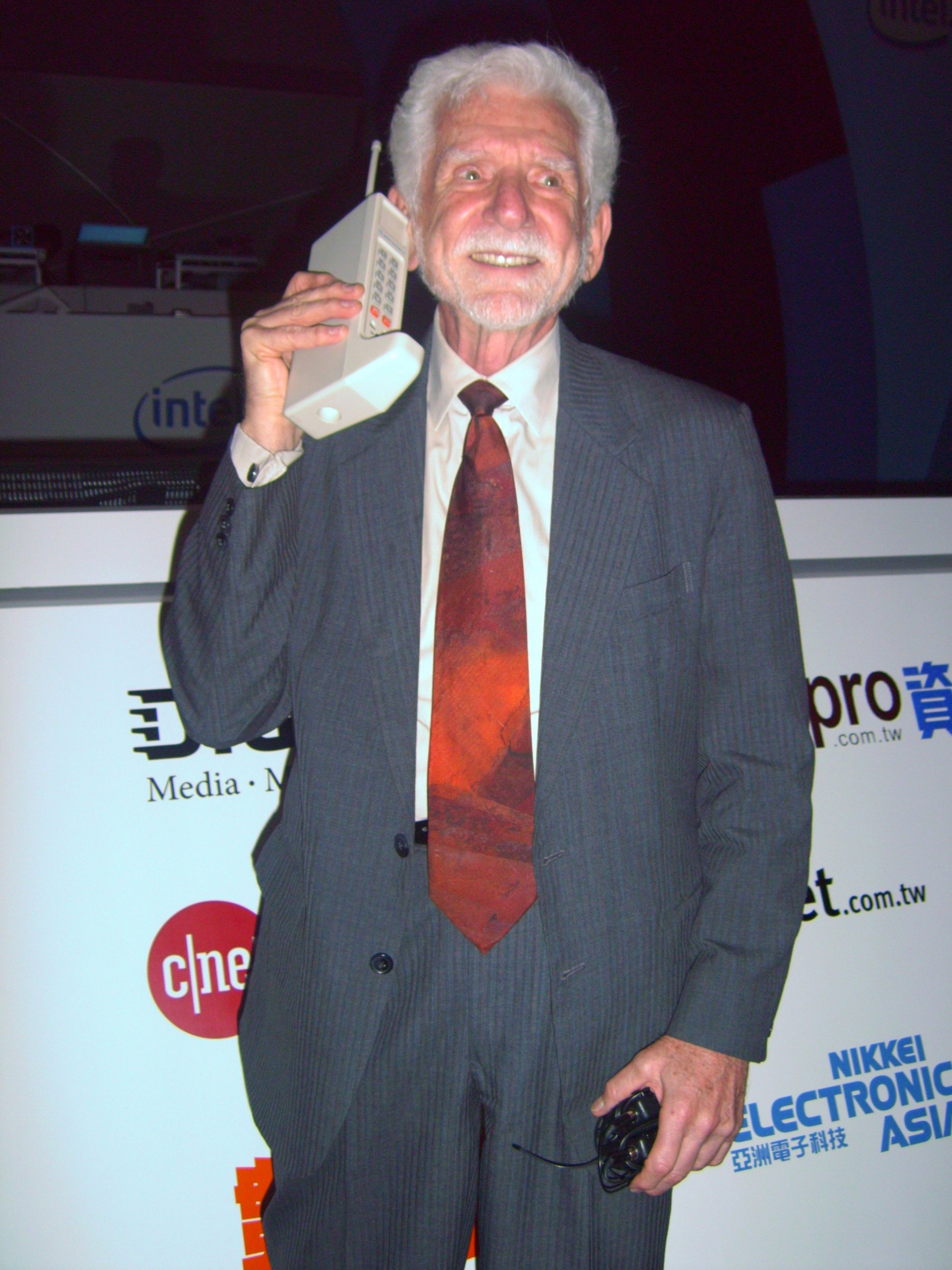 Motorola's Martin Cooper reenacting the world's first hand-held mobile phone call with the Motorola DynaTAC