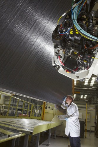 A GKN engineer inspects a composite wing spar