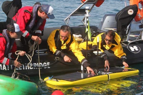 Waveglider receiving last minutes checks before being deployed