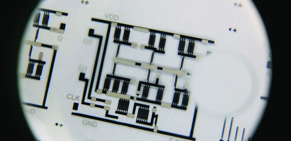 A low-cost complex electronic circuit printed on a transparent plastic sheet
