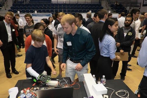 Engineering student Kevin Gravesmill demonstrates the Hands Omni glove created at Rice University for virtual reality gaming systems at the annual Engineering Design Showcase