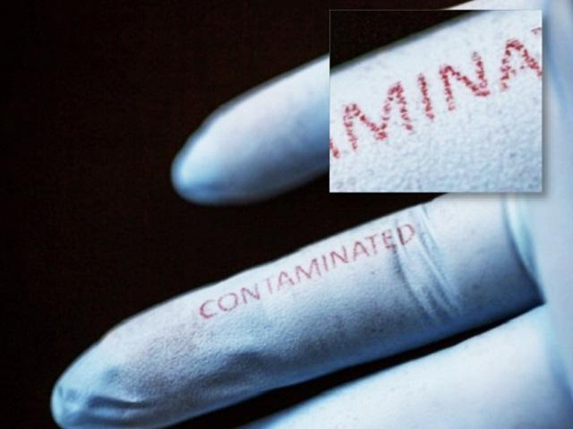 "Silk inks doped with bacteria-sensing agents were printed on surgical gloves using inkjet technology. The word ""contaminated"" changed from blue to red after exposure to E. coli."