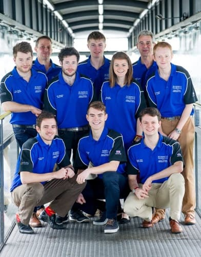 Front left: Jack Fairweather – Finance Front middle: Sam Clifton – Chassis Front right: Stuart Snow – Electronics and Novel Design Mid far-left: TheoSaville – Chief Engineer Mid left: Matt Shanahan – Sponsorship Mid right: Verity Armstrong – Publicity and
