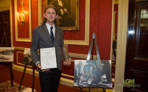 Pontus Merkel alongside a sketch for his winning entry.