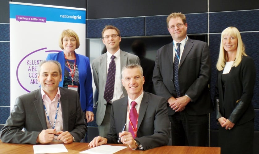Representatives from the University of Warwick and National Grid sign the MoU.