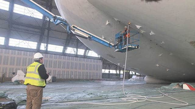 Airliner being filled with helium prior to floatation