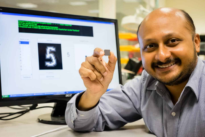 NTU Asst Prof Arindam Basu is holding his low-powered smart chip.NTU Asst Prof Arindam Basu is holding his low-powered smart chip. Image courtesy of NTU Singapore