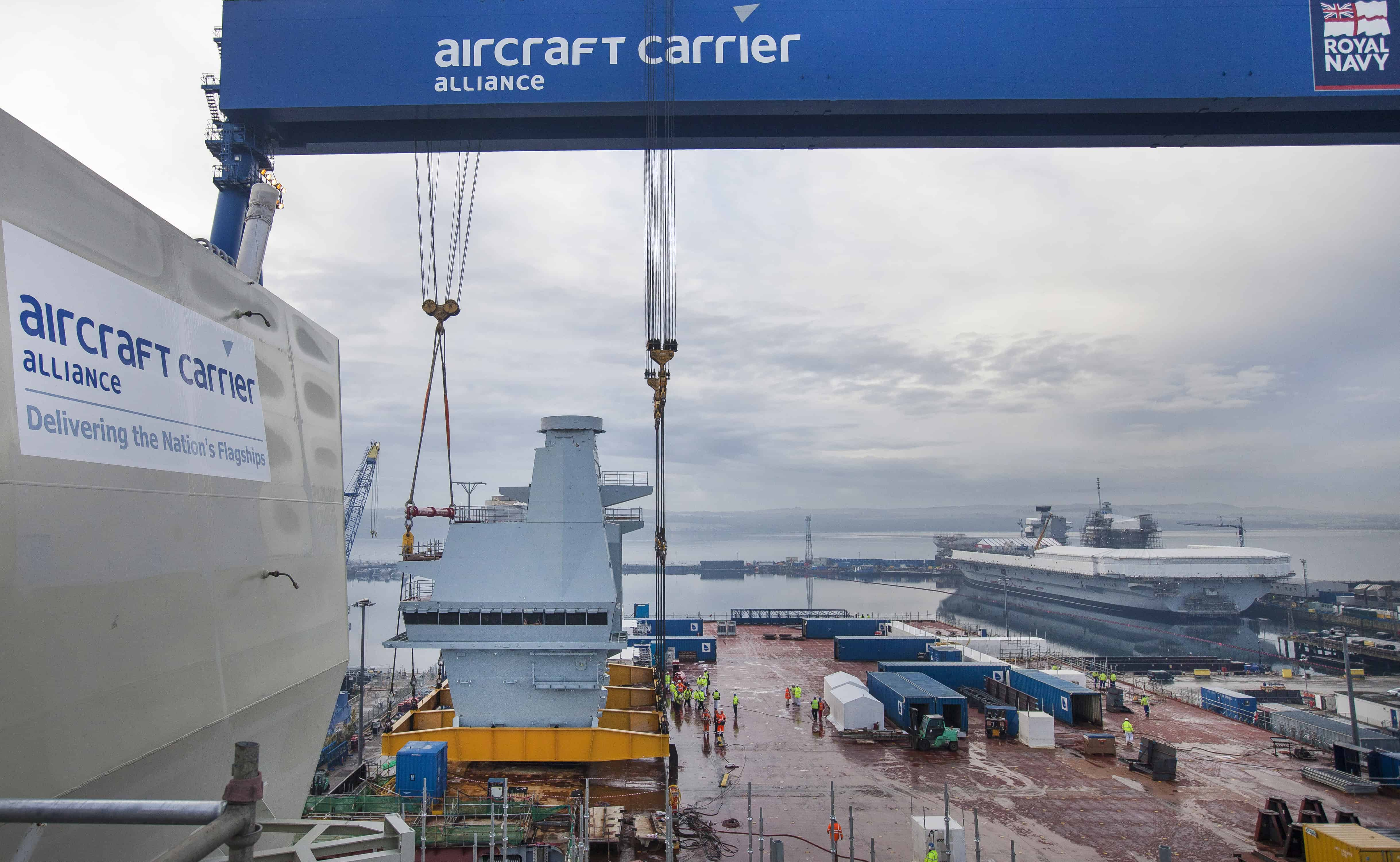 Prince of Wales Aircraft Carrier Construction Rosyth Naval Dockyard, Friday 8 January  The Aft Island, which will control aircraft operations aboard HMS PRINCE OF WALES, has been lifted on to the deck of the ship. Rosyth, UK: HMS QUEEN ELIZABETH and HMS PRINCE OF WALES will be the Royal Navy's largest and most advanced ever warships and were constructed in blocks in different shipyards throughout the UK. The final section being delivered, known as the Aft Island, weighs 750 tonnes and will control aircraft operations aboard the second aircraft carrier, HMS PRINCE OF WALES. The Aft Island, which will control aircraft operations aboard HMS PRINCE OF WALES, has been lifted on to the deck of the ship. Photo Credit Drew Farrell / BAE Systems First Use Supplied Courtesy of BAE Systems For Further Details : Please contact Drew Farrell (photographer) T : 07721735041 Sofia Naz ACA Communications Associate T 01622 778533 | M 07525078502 | sofia.naz@baesystems.com www.baesystems.com