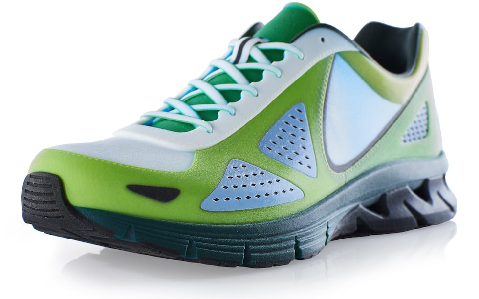This true product-matching sports shoe prototype was produced with full color, smooth surfaces, and a rubber-like sole - all in a single print operation on the Stratasys J750 3D Printer
