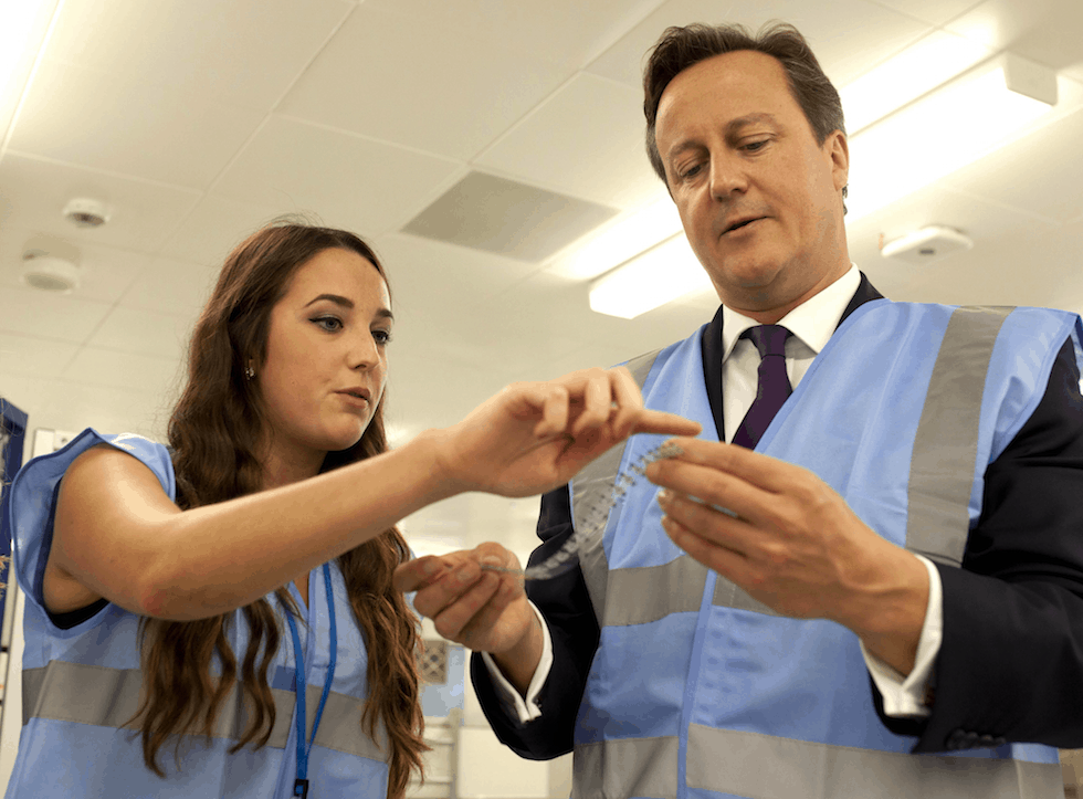 Rebecca Lowe with David Cameron during the PM's visit to Abbott's Witney facility