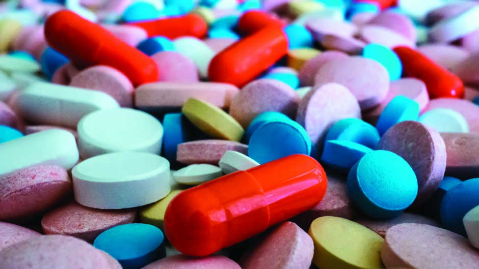 Heap of medicine pills. Close up of colorful tablets and capsules.