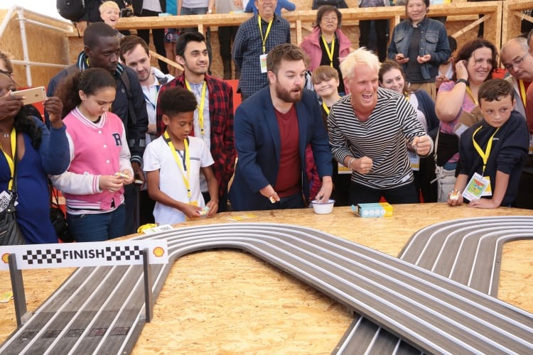 Journalist and presenter, Alex Brooker, left shares a laugh with actor and television presenter Jamie Laing in the Make Zone during Make the Future London 2016 at the Queen Elizabeth Olympic Park, Saturday, July 2, 2016 in London, UK. (Jeff Moore for Shell)