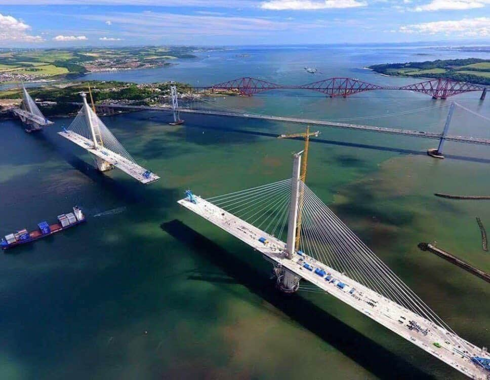 Past, present and future: the Victorian Forth Bridge (background); the 1960s Forth Road Bridge (centre) and Queensferry Crossing, under construction in the foreground