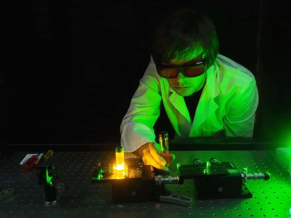Dr. Erik Schartner demonstrates an experimental system of the optical fibre probe. (Credit: University of Adelaide)