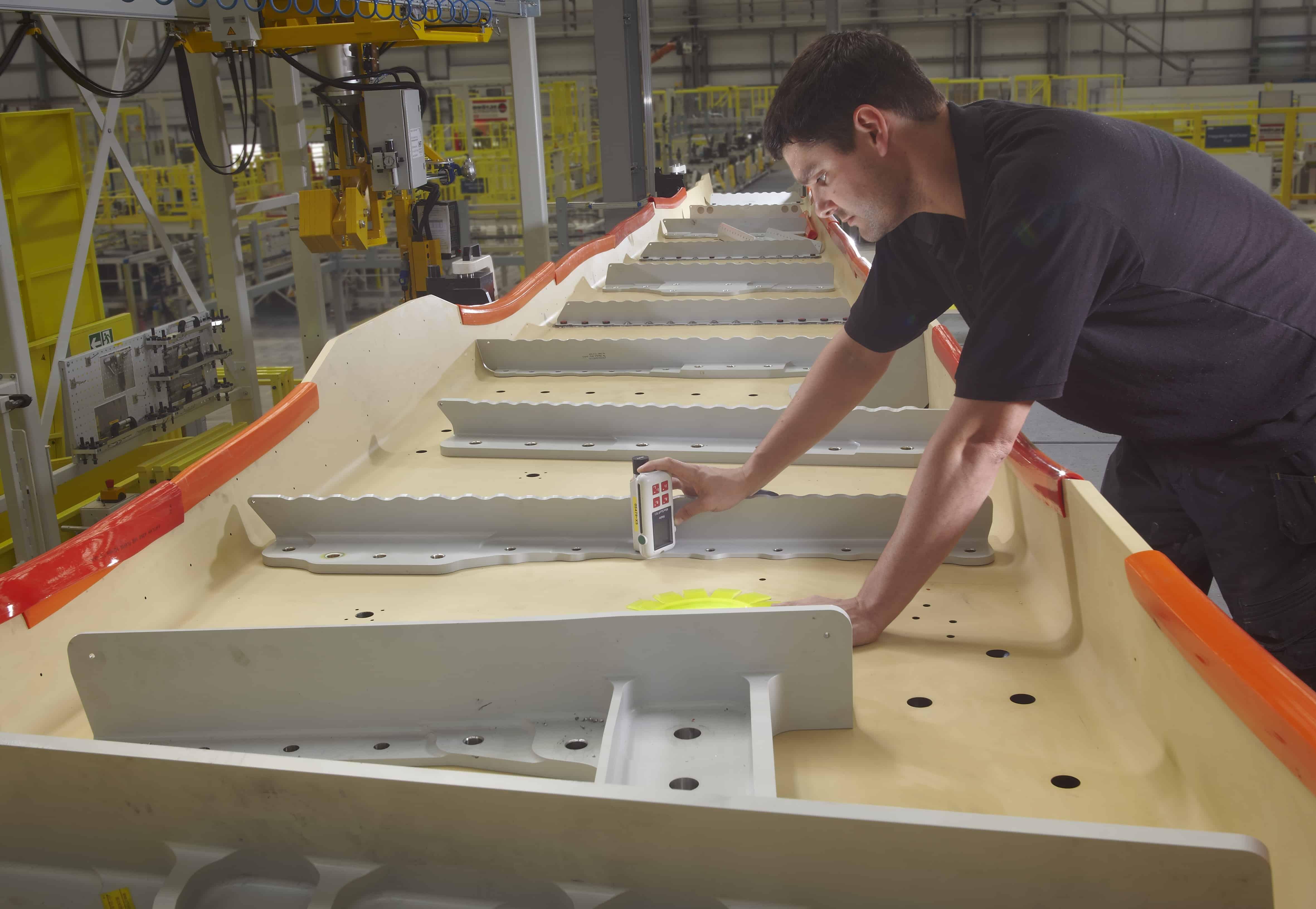 Inspecting the composite rear spar: the component has a complex 3D shape.