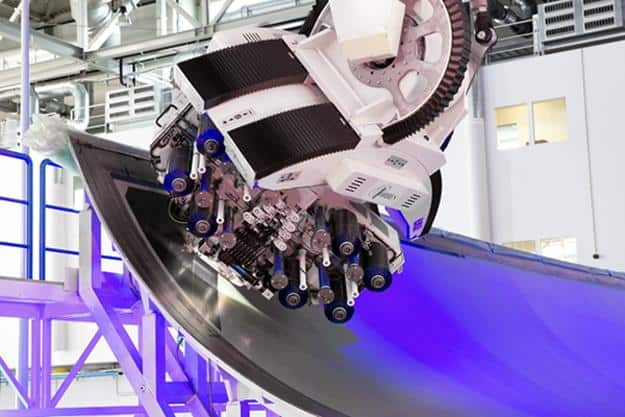 The MTorres automated fibre placement head at Airbus applying composite tape to an A350 wing cover tool