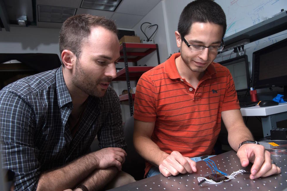 Jacob Robinson, left, assistant professor of electrical and computer engineering, & graduate student Daniel Gonzales (Jeff Fitlow/Rice University)