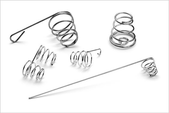 Conical formed compression battery springs
